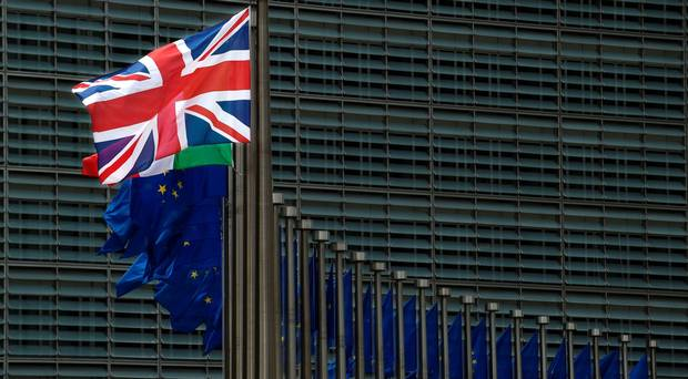The Union flag flies outside the EU headquarters in Brussels