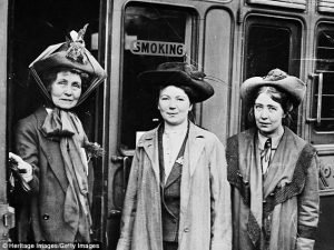 Emmeline (left), with her daughters Christabel (centre), and Sylvia Pankhurst, (right), pictured at Waterloo Station in 1911