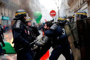 Macron: French riot police grab a protester during a rail workers' march in Paris last week. Photo: Christophe Ena