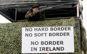 """Members of the anti-brexit campaign group """"Border communities against Brexit"""", dressed as British Army Soldiers CREDIT: PAUL FAITH"""