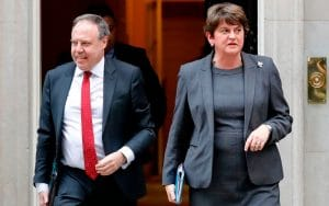 DUP leader Arlene Foster and deputy Nigel Dodds leave 10 Downing Street in September  CREDIT: TOLGA AKMEN/AFP