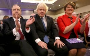 Deputy Leader of the DUP, Nigel Dodds, former  Boris Johnson and leader of the DUP Arlene Foster attend the DUP Annual Conference in Belfast in September 2018 CREDIT: PAUL FAITH/AFP