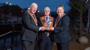 Roy Kells (centre) receives an Orange Order lifetime achievement award from grand master Edward Stevenson (left) and deputy grand master Harold Henning