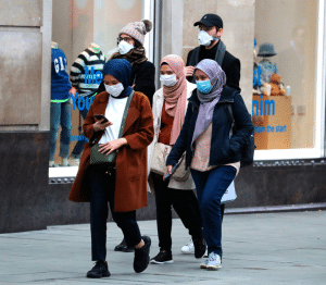 Shoppers wearing face masks in a bid to avoid infection during the coronavirus crisis