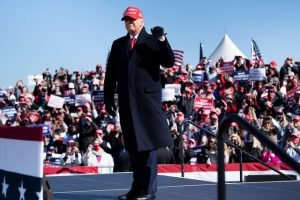 US President Donald Trump arrives for a Make America Great Again rally in North Carolina on Monday November 2, just before the election. The president could behave like a needy child, writes Ruth Dudley Edwards, but he did not forget his promises and gave incentives to the repatriation of jobs and made the economy roar (Photo by Brendan Smialowski / AFP)