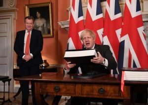 The then UK chief trade negotiator David (Lord) Frost as Boris Johnson signs the EU-UK deal on December 30. Lord Frost, who has been elevated to the cabinet, should be unleased to find a fair solution that is fair to the law abiding people of Northern Ireland. Photo: Leon Neal/PA Wire