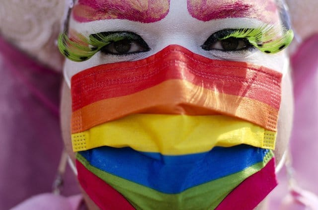 A person with a rainbow colored face mask attends a pride rally for visibility and freedom in Berlin, Germany, Saturday, June 26, 2021. (AP Photo/Markus Schreiber)