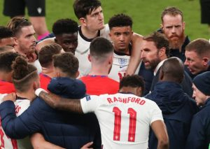 England manager Gareth Southgate, seen above talking to his players during the Euros final, has taught values that contrast with those of show-offs of past generations who spent their money on champagne
