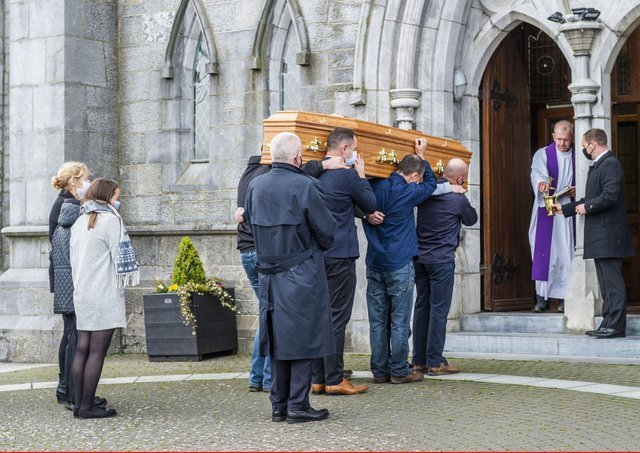 Anne O'Sullivan, in the middle of the three people on the left of the photograph, watches as the coffin of her son Mark is carried into the Church of the Immaculate Conception, Kanturk, Co Cork, for his funeral. Mark was murdered by his brother Diarmuid his father Tadgh